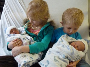 kids holding twins