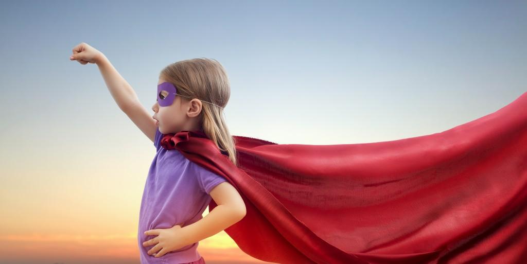 girl dressed up as superhero