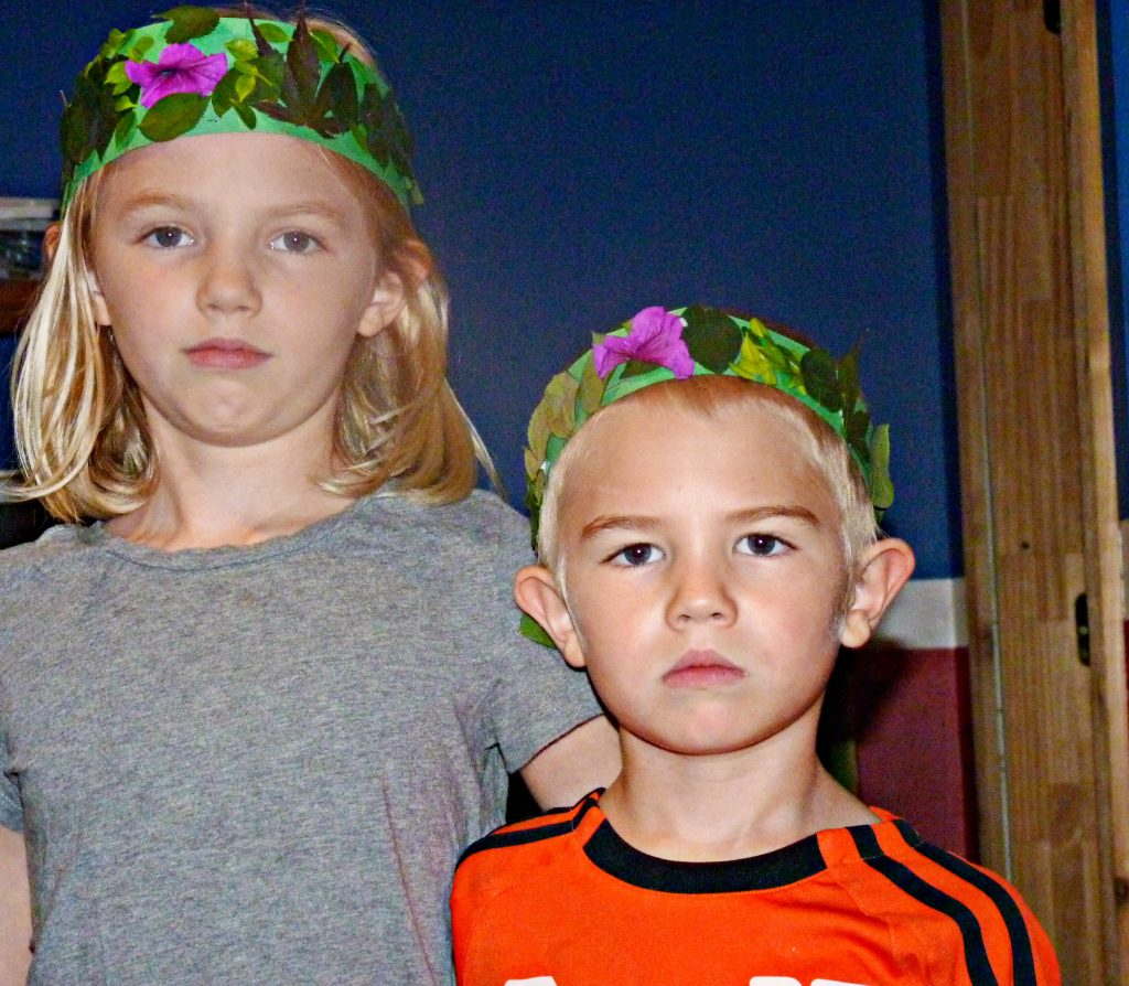 ittle Olympians with olive leaf crowns